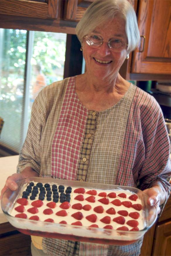 Grandma, pictured with a 4th of July pie, happily un-bench pressed.